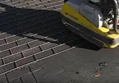 stamping asphalt with brick design using a stamping machine